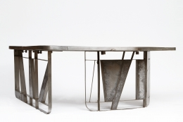 Modernist cement and iron desk, full view from eye-level