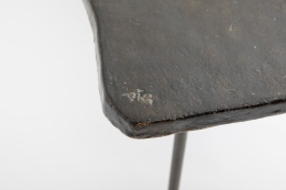 Annie Fourmanoir's ceramic coffee table, detailed view of signature on table top corner