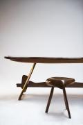 "Michel Chauvet's stool installation view with Chauvet's ""Poisson"" sculptural desk behind"