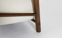 Attributed to Charlotte Perriand, pair of armchairs, detailed view of wooden legs on single chair