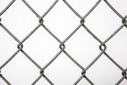 """Paul Ludick's """"Apartheid"""" chair, detailed view of chain linked fence"""