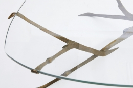 Felix Agostini's coffee table view of glass top with bronze base