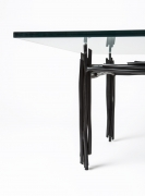 Howard Meister's painted metal coffee table, detailed view of one side of the table from eye-level view