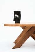 """Pierre Chapo's """"T35C"""" dining table installation view cropped with Alexander Noll's sculpture on top"""