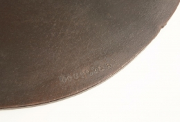 Alain Douillard's leather chair detailed view of signature