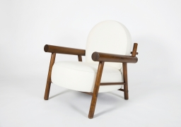 Attributed to Charlotte Perriand, pair of armchairs, single chair diagonal side view