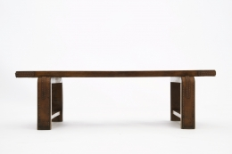 Jacques Adnet's coffee table/bench straight view from eye-level