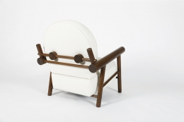 Attributed to Charlotte Perriand, pair of armchairs, single chair back diagonal view