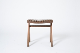 Pierre Jeanneret's pair of stools, full view of single stool from eye-level