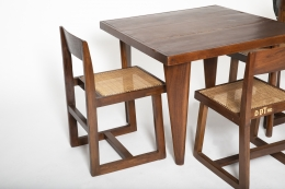 Close up view of Pierre Jeanneret's square table shown with set of 4 Jeanneret chairs