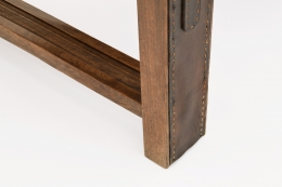 Jacques Adnet's coffee table/bench detailed view of leather and wood of leg