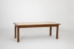 Jacques Adnet's coffee table, full eye-level view on a diagonal