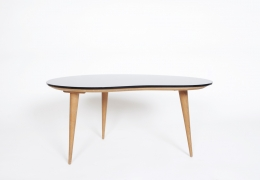 Jean Royère's free form coffee table, full view from eye-level