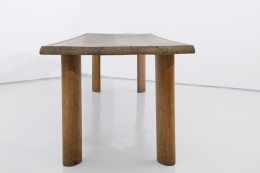 """Charlotte Perriand's """"Table a gorge"""" dining table, full view from one end of the table"""