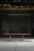 """Pierre Chapo """"T14C"""" dining table installation image in warehouse with """"D08"""" extensions"""