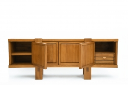 "Pierre Chapo's ""R16"" sideboard with two doors opens on the sides"