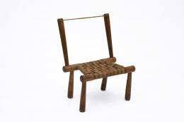 Gaston Castel's wooden chair diagonal view