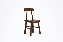 Alexandre Noll's wooden chair, front diagonal view