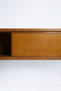 """Pierre Chapo's """"Le Pettit"""" sideboard detail view of door open and leather"""