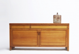 "Pierre Chapo's ""R08"" sideboard straight view with ceramic vase on top"