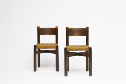 "Charlotte Perriand's set of 6 ""Meribel"" chairs, front view of two"