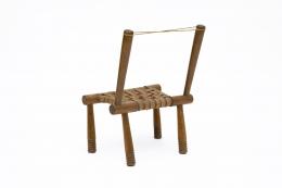 Gaston Castel's wooden chair back diagonal view