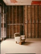 Studio Giancarlo Valle's puff chair with legs, full front diagonal view