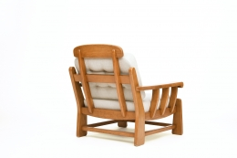 Maison Regain's pair of armchairs, back diagonal view of single armchair