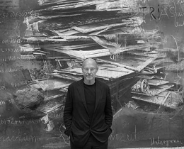 Photo of Anselm Kiefer in front of his work 'Ages of the World' (2014)