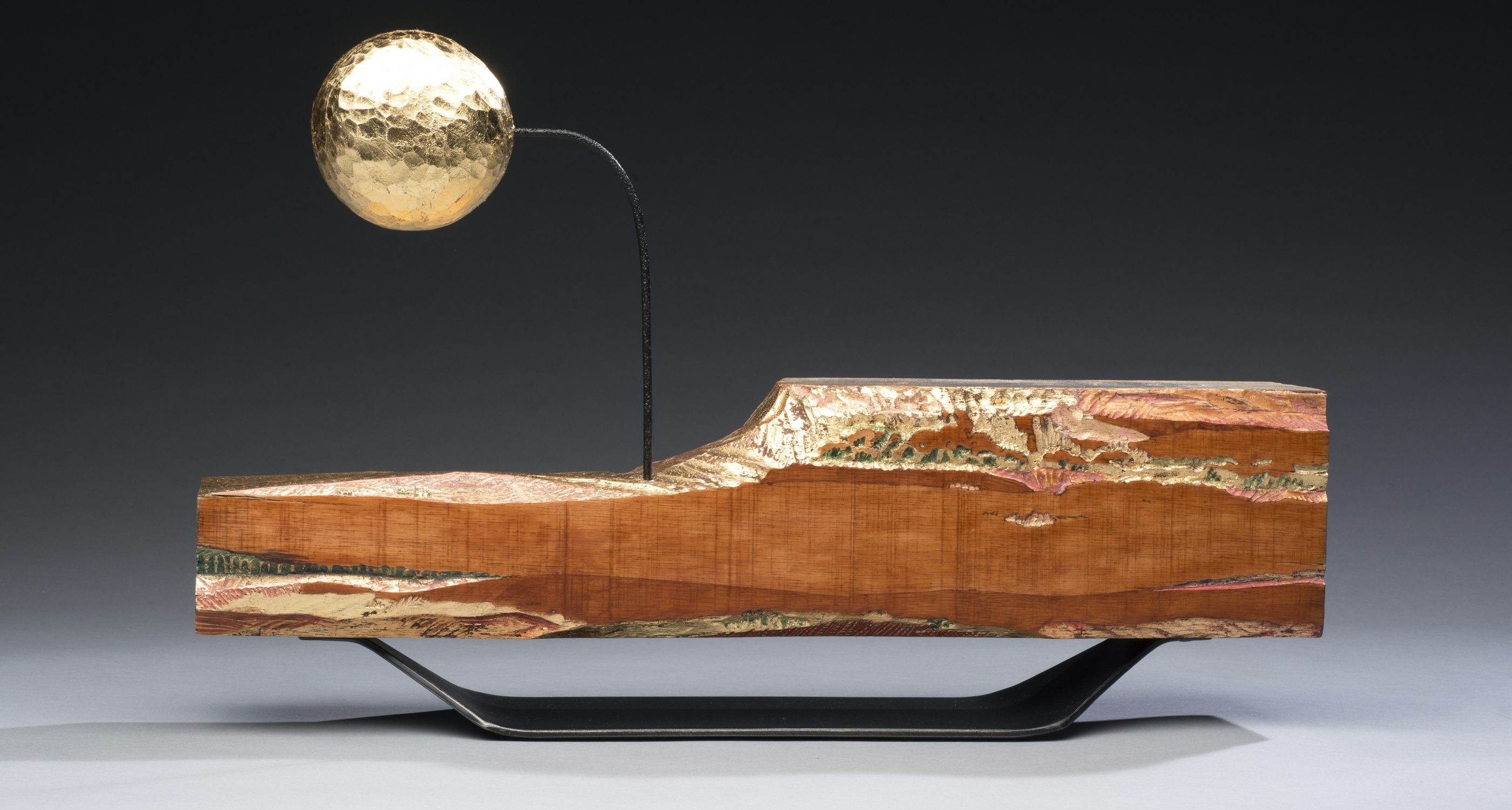 "14. Sergio Tapia (b.1972) ""Sunset, Moonrise,"" carved and gilt bass wood with metal, 10 1/2 x 16 3/4 x 4 inches"