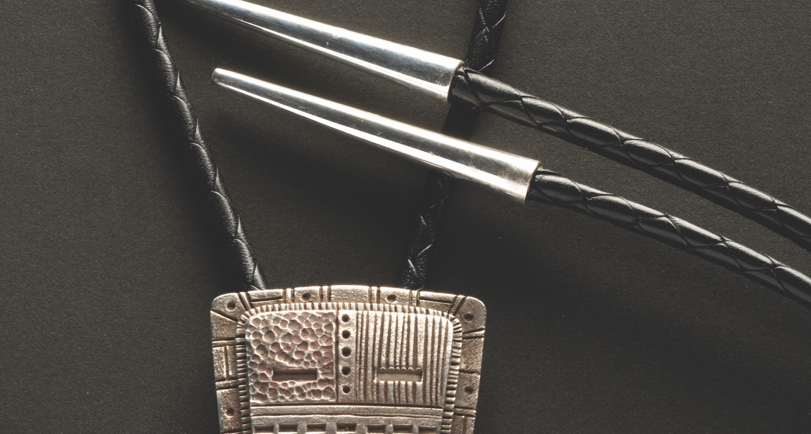 """11. Tony Abeyta (b.1965) """"Night Chanter,"""" sterling silver stamped bolo, 2 inches high x 1 3/4 inches wide"""