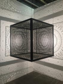 Anila Quayyum Agha Crossing Boundaries Ed. of 2 2016 Laser cut black stainless steel and bulb 48 x 48 x 48 in.