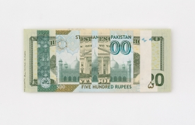Abdullah M. I. Syed  Weaving Overlapped Realities: 20 US Dollar and 500 Pakistani Rupee (Structures, Verso), 2020  Hand-cut and overlapped uncirculated 20 US Dollar and 500 Pakistani Rupee and archival tape  2.60h x 6.10w in