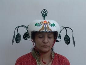 Adeela Suleman, White Helmet with green wings, 2008, Steel cooking utensil, steel spoon, cycle ornament, powder coated and enamel painted, 18 x 13 x 15 in