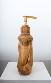 A soap dispenser, scaled up and hand carved out of wood.