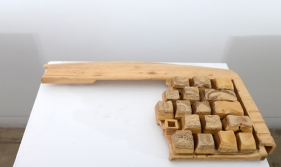 A broken keyboard, scaled up and hand carved out of wood.