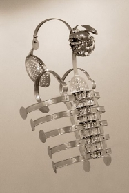 Adeela Suleman, Case 5, 2008, Steel drain covers, tongs, nuts and bolts, measuring and frying spoons, 34 x 14 x 11 in