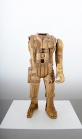 A broken toy soldier, scaled up and hand carved out of wood.
