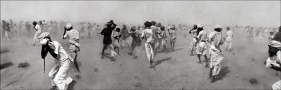 Raghu Rai DUST STORM CREATED BY A VIP HELICOPTER, RAJASTHAN 1975 Digital scan of photographic negative on archival paper 20 x 62 in.