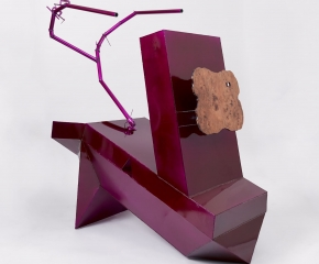 A large fuchsia sculpture made out of aluminum, with scorpion-like stinger and a face made of polished wood