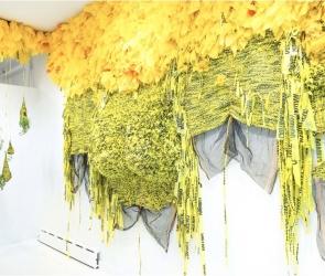 Installation image of Borinquen Gallo hanging sculpture