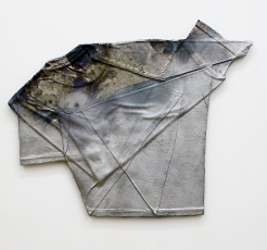 An aluminum tshirt with paint at the top-left corner