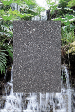 A poster with asphalt in the center framed by an image of a waterfall and tropical trees