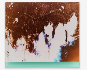 An abstracted photograph with orange, blue, and white, installed on blue plexiglass