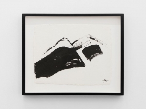 An abstract drawing of a mountain range, framed in black.