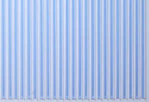 A photograph of blue ribbon hanging in a straight line on a wall