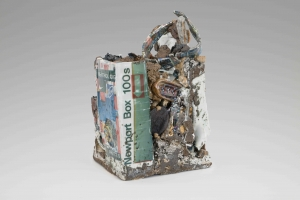 A mixed clay sculpture with decals, varied lusters, and imagery