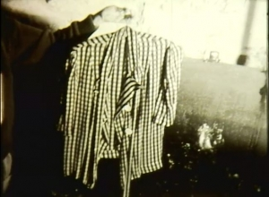 A screenshot of a black and white shirt held up on a hanger