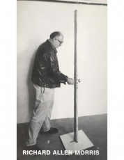 Richard Allen Morris with Giacometti's Door, 1980, wood and metal, 79 X 6 X 5 in. Photo: Mary Kristen and Anna O'Cain. Exhibition brochure for Richard Allen Morris: A Sense of Place, Mandeville Gallery, University of California San Diego, February 27 – March 27, 1988 and La Jolla Museum of Contemporary Art Downtown, April 16 – July 3, 1988.