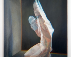 A semi-photorealistic painting of a naked woman kneeling on the ground, looking at a clear mask in her hands. She is looking at a grey wall, which projects her shadow. there is a black wall behind her, outlined in yellow/orange like a light is lit behind it.